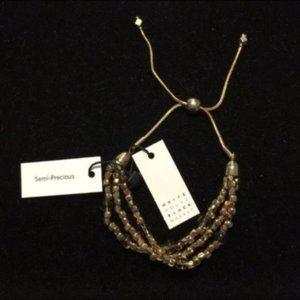 White House Black Market Gold beaded bracelet